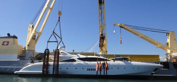 Superyacht ready to be loaded onto the deck of the vessel