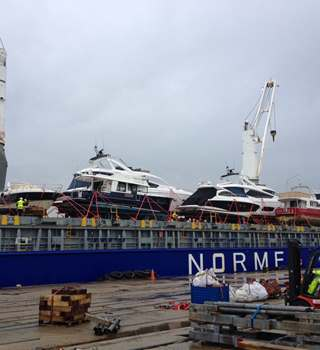 Yachts loaded onto a Normed vessel ready for shipping