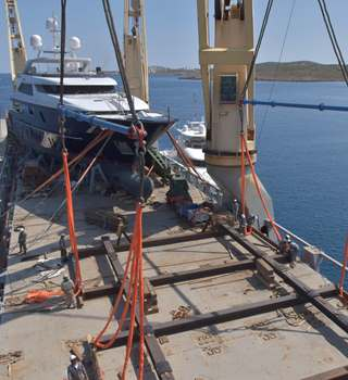 San Lorenzo Superyacht loaded and secured on the deck of a vessel