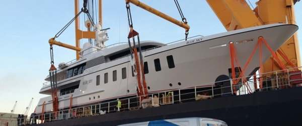 Peters & May vans portside next to Superyacht loaded on to vessel