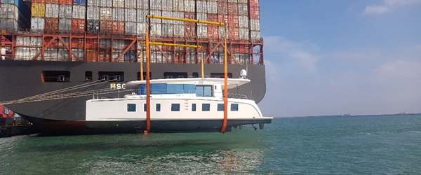 Silent Yacht 55 being lifted on board a vessel for shipment