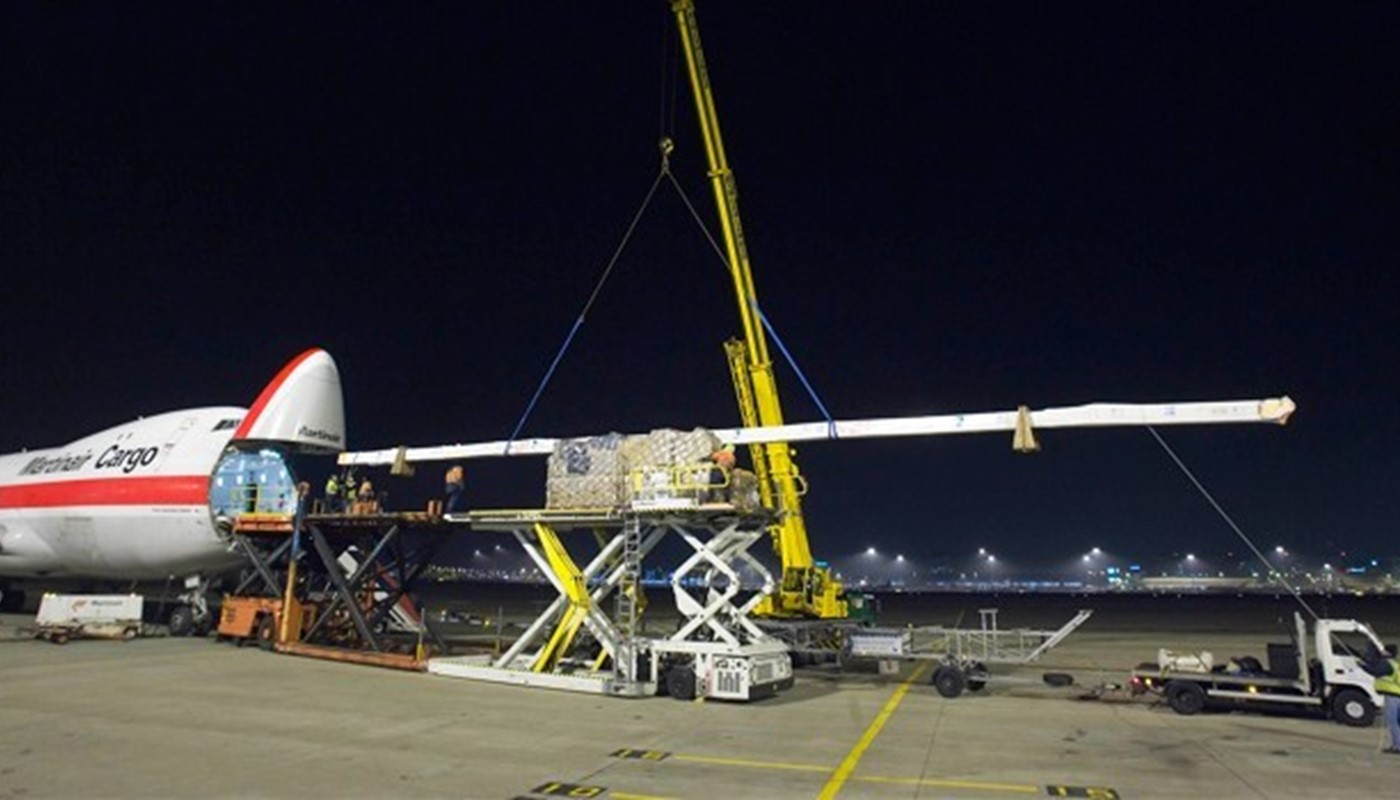Volvo Brasil mast being loaded on board an airplane ready to be air freighted