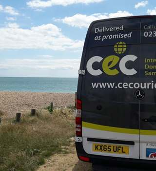 CEC van parked on coastal road by the sea