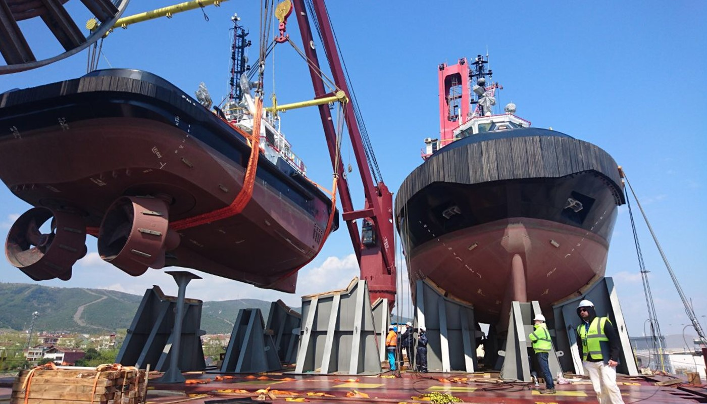 Commercial Transportation of two tugs shipping to South America