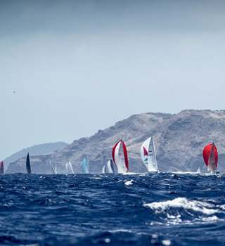 Antigua Sailing Week Racing Yachts just off the coast at sea
