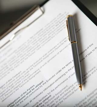 Policy document with a pen