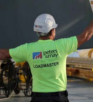 Peters & May Loadmaster loading a yacht onto a vessel for shipment
