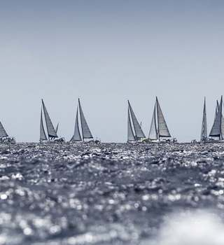 Antigua Sailing Week Racing Yachts on the Horizon