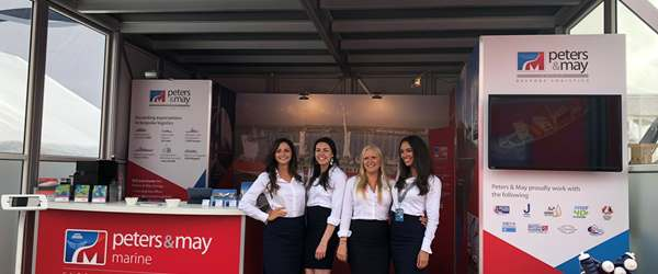 Staff standing at the Peters & May stand during Southampton Boat Show 2018