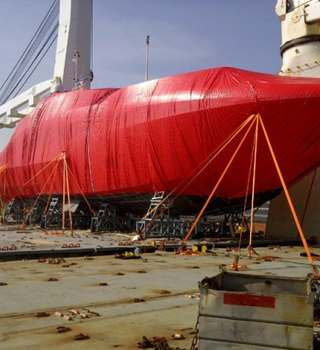 Shrink wrapped boat lashed to deck
