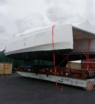 Shrink wrapped Trimaran lashed