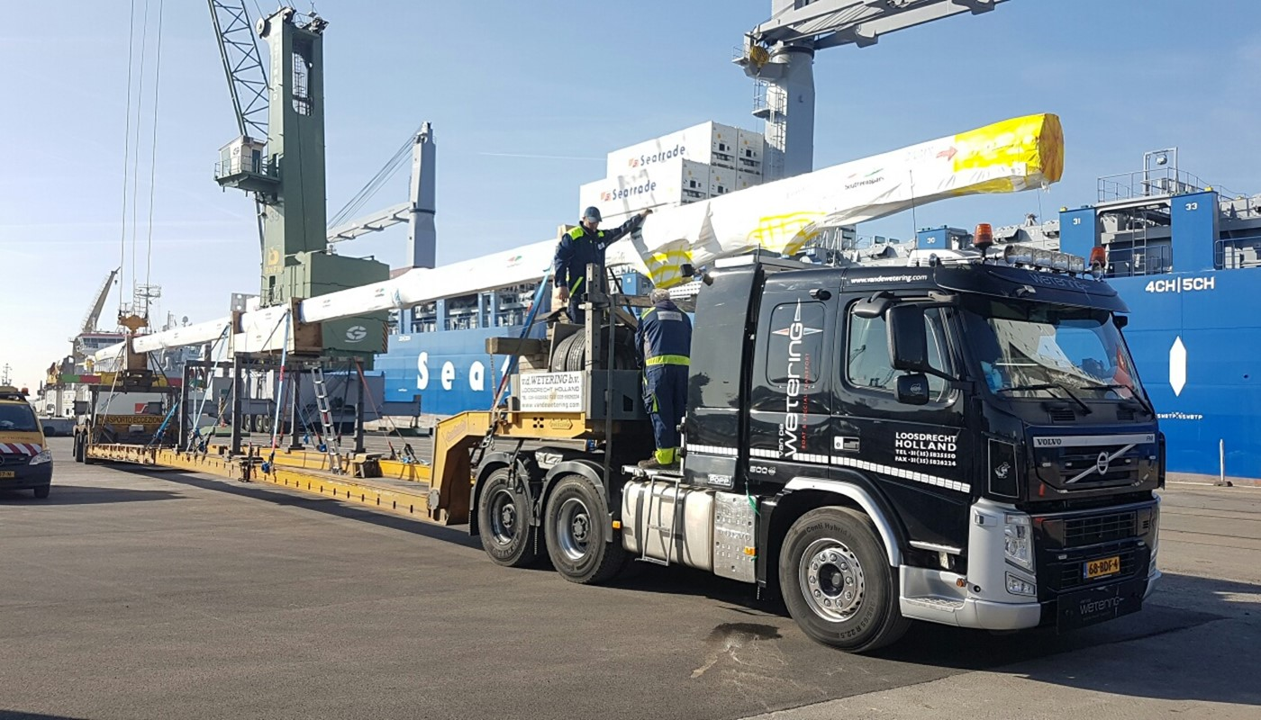 Mast arriving by truck ready to be loaded onto a vessel for shipment
