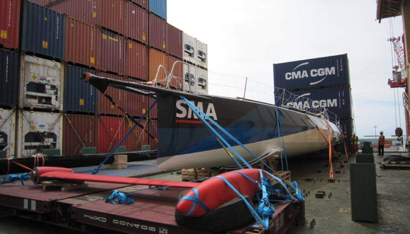 Racing yacht loaded on board a container vessel