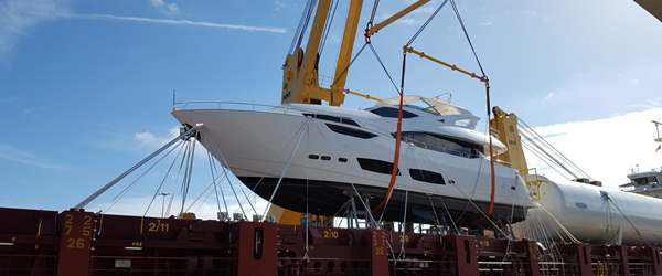Sunseeker loading onto deck of a vessel ready for shipping