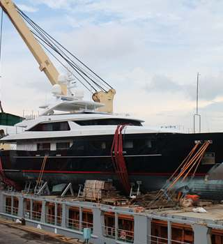 Superyacht 'Forwin' lashed on deck of a vessel