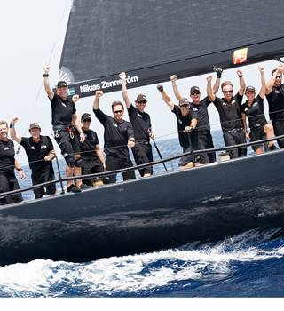 52 Super Series Team Celebrating after a race