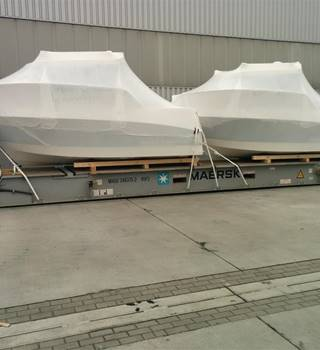 Pegazus boats loaded and wrapped for shipping