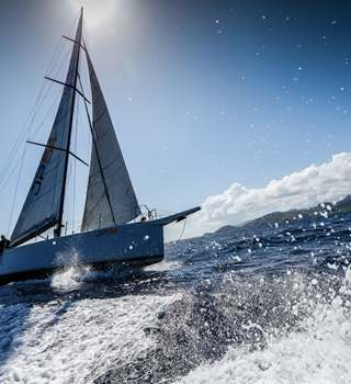 Yacht sailing on the waters around Antigua for Antigua Sailing Week 2019