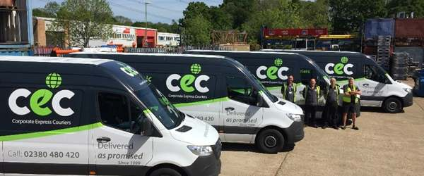 4 vans of the CEC fleet lined up with drivers