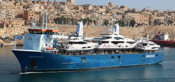 Yacht on desk arriving into Malta - Using Peters & May global yacht transportation experts