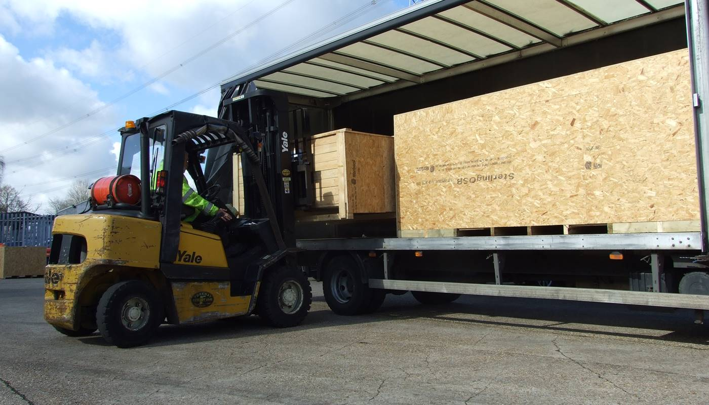 Freight being loaded onto a truck ready for transport